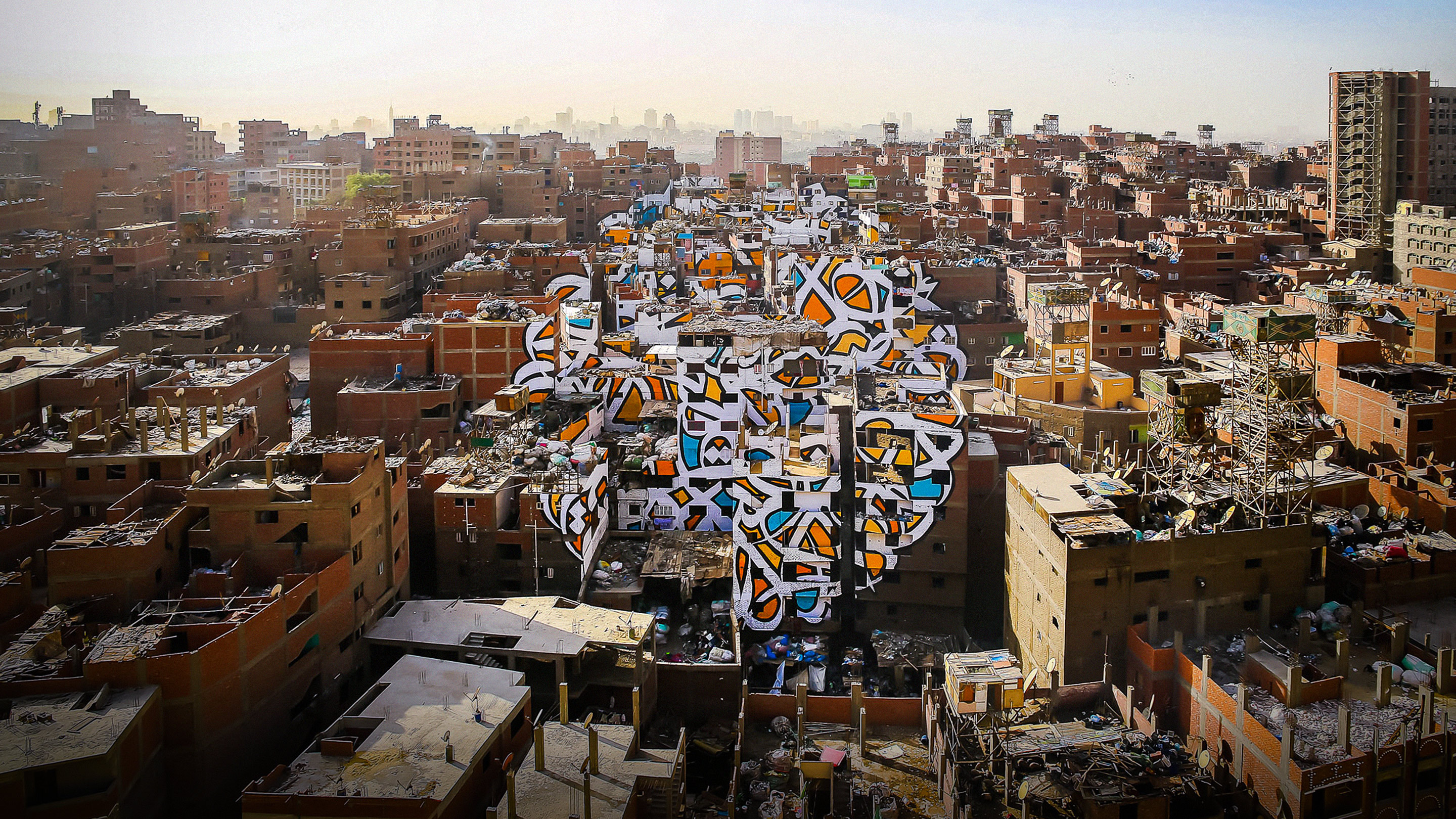 eL Seed: A project of peace, painted across 50 buildings thumbnail